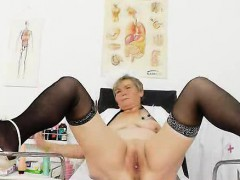 Cougar masturbation with a...